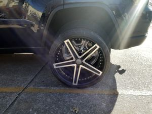 "20"" rims n tires.....5 lug two tires brand new two will need replaced soon for Sale in Rogers, AR"