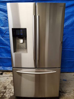 Samsumg stainless steel fridge good working conditions for $399 no ice maker or water but fridge and freezer working good for Sale in Denver, CO