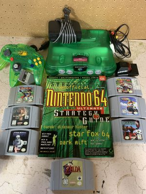 Nintendo 64 (jungle green n64 ) with 7 games , 1 controller, memory card , and tremor pak, (Zelda ocarina of time , Star Fox , Star Wars , killer ins for Sale in Kennewick, WA