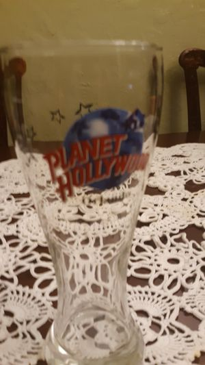 Highly collectible pilsner glass from Planet Hollywood in Orlando, Florida Height: approx 8.5 inches tall width at brim: approx 3.25 inches for Sale in Sanford, FL