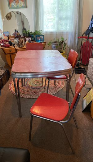 Retro 50s table and chairs four chairs a table extension three chairs are in good shape one needs a back rest also one kitchen stepping stool seat al for Sale in Seattle, WA