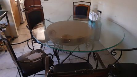 Glass dining table and chairs for Sale in Riverside,  CA