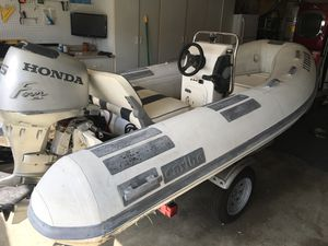 11' Caribe inflatable boat center console dinghy for Sale in HUNTINGTN BCH, CA