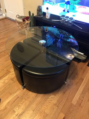 Adjustable height glass coffee table with 4 leather storage ottomans for Sale in Brooklyn, NY