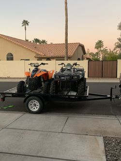 2 Great Polaris ATVs and the trailer! for Sale in Chandler,  AZ