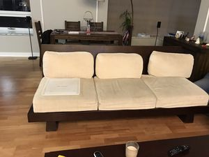 Solid wood couch with love seat and coffee table with console table Roys furniture store for Sale in Chicago, IL