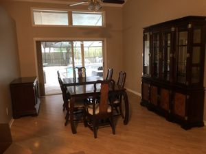 Wood dining room set. Lighted China closet with doors and shelf below, buffet with drawers and shelves, 72 inch table with 6 upholstered chairs for Sale in Tampa, FL