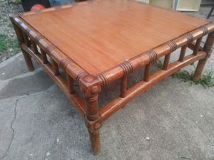 Solid wood bamboo looking coffee table good condition asking 120 or best for Sale in Houston, TX
