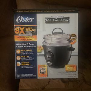 Oster Ceramic Rice And Grain Cooker With Steamer for Sale in Winter Haven, FL