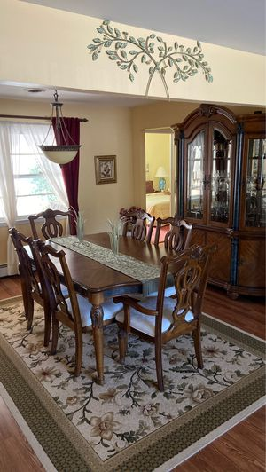 Dining room table and china closet for Sale in Toms River, NJ