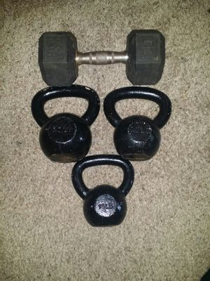 Iron kettle bells 15lb, 20lb, 25lb and one 30lb rubber dumbbell. for Sale in Deerfield Beach, FL