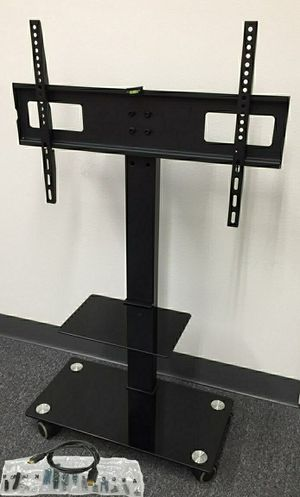 Brand new in box TV stand on wheels universal fits 32 to 65 Inch TV sizes flat screen LCD plasma for Sale in Whittier, CA