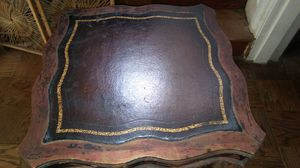 """ROSEWOOD INLAID LEATHER TOP TABLE 24"""" IN DIAMETER, IN GOOD STURDY CONDITION WITH SEVERAL CHIPPED SPOTS AS SHOWN IN PICS. SEE DESCRIPTION FOR MORE. for Sale in Baltimore, MD"""