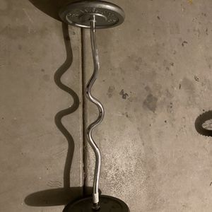Curl bar with two 25lb weights for Sale in Glendale, AZ