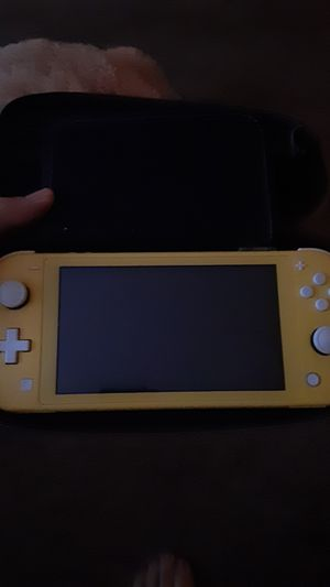 Nintendo switch lite with extra 64gb memory and games for Sale in Quincy, IL
