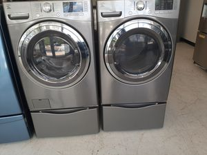 Kenmore front load washer and electric dryer set with pedestal used in good condition with 90 day's warranty for Sale in Mount Rainier, MD