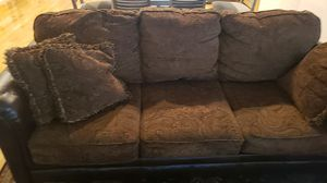 Brown sofa and love seat half leather and fabric bought from the old cannery great shape no rips stains or bad smells cleaned often for Sale in Enumclaw, WA