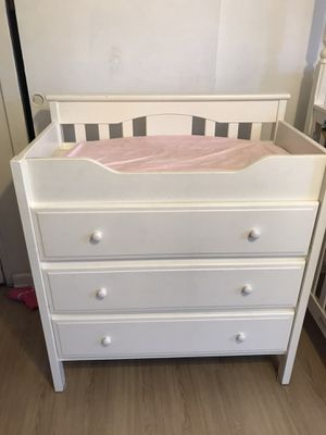 Baby changing table three drawer dresser all white with changing pad and two covers green and pink for Sale in Hawthorne, CA