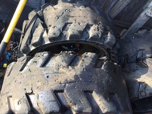 33x12.20 solideal Solid rubber skid steer tires for bobcat with rims for Sale in Boston, MA