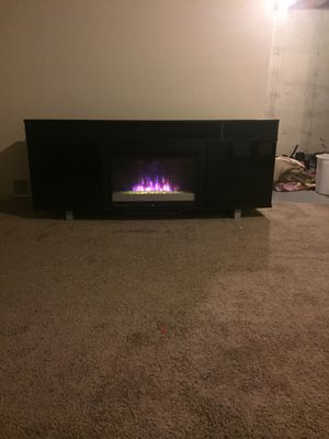 Very nice entertainment center. Black with glass doors to hide the storage shelves. Also a built in SOUND BAR!!! for Sale in Comstock Park, MI