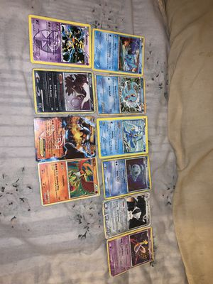 Pokemon legendary cards + black and white handbook for Sale in Santa Ana, CA