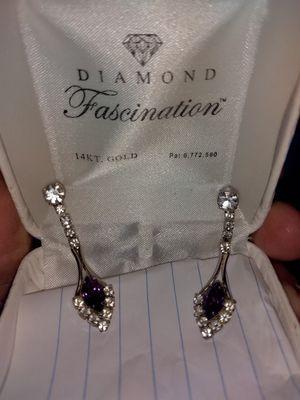 Diamond Fascination 14kt gold earrings for Sale in Hillsboro, MO