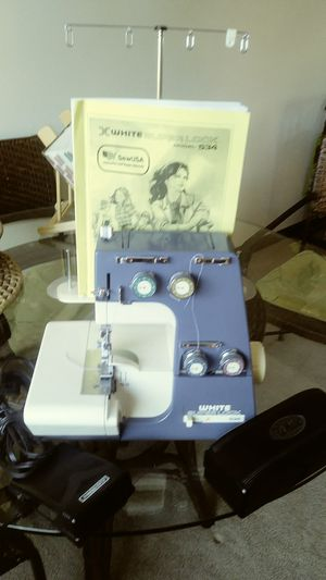 White serger sewing machine for Sale in Lakewood, CO
