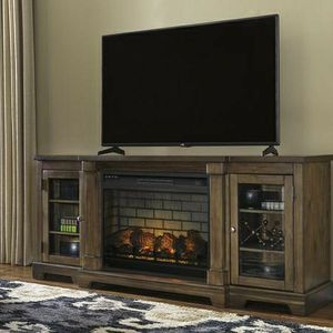 Flynnter Medium Brown XL TV Stand w/Fireplace Option On Sale 10 Percent Down Take .We Deliver for Sale in Houston, TX