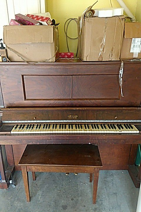 Story and Clark early 1900's self playing piano with over 50 music rolls and bench included.