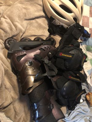 One pair Infinity rollerblades size 7 plus pads and helmet for Sale in Morrisville, PA