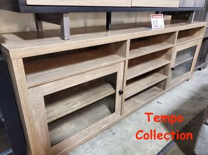 NEW IN THE BOX. TV STAND / ENTERTAINMENT CENTER FOR TVS UP TO 95IN TVS, HAZELNUT , SKU# TC172174TVS for Sale in Santa Ana, CA