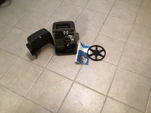 Bell and Howell auto-load Super 8 projector. New lamp and extra reel. for Sale in Burien, WA