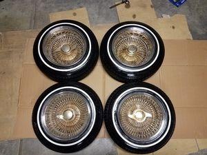 13x7 Center gold 100 spoke wire rims white wall 155/80R13 tires still have good tread cash or trade 14x7 tru classics 13 inch supremes for Sale in Dinuba, CA