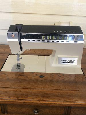 Athena 2000 sewing machine and cabinet for Sale in McCalla, AL