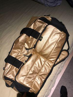 Jordan gold and black duffel bag for Sale in Tempe, AZ