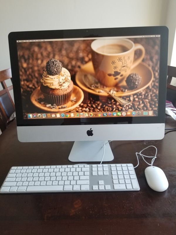 21.5 inch apple computer with keyboard and mouse