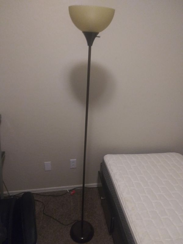 Lamp, dresser, glass desk, and small nightstand.