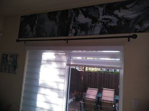 Brown curtain rod with 2 blue curtains for Sale in Miami, FL