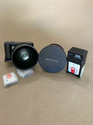 Sony dsc-hx9v Cyber-shot camera with special bracket that holds the camera and lens. 3 battery's & charger 2 lenses for Sale in Whittier, CA