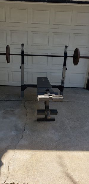 Olympic bench press,bar and 35lb weights for Sale in San Bernardino, CA