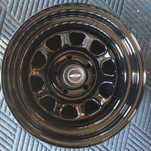 "15"" brand new black rally wheels with to sets of center caps for Sale in Waldorf, MD"