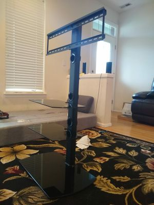 Fitueyes universal floor TV stand with swivel mount tempered glass base & shelves for 32 to 65 inch lcd led plasma TVs for Sale in Issaquah, WA