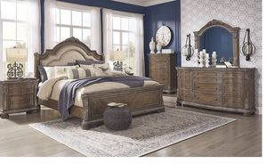Charmond - Brown - 7 Pc. - Dresser, Mirror, King UPH Sleigh Bed & 2 Nightstands for Sale in Naples, FL