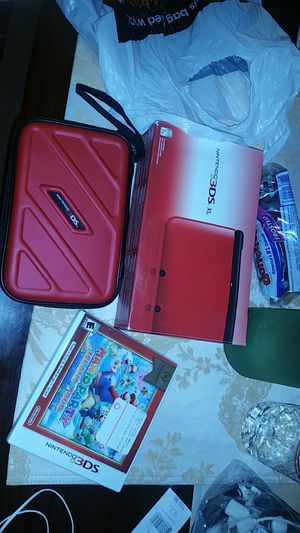 Nintendo 3DS Xl and Nintendo 3DS case and Mario game for Sale in Haverhill, MA
