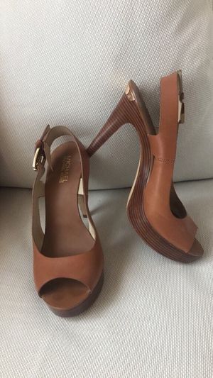 Michael Kors Brown leather strapped heel for Sale in Denver, CO