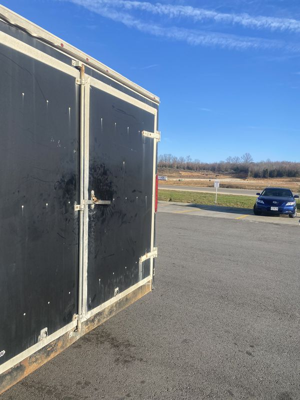 Utility enclosed trailer