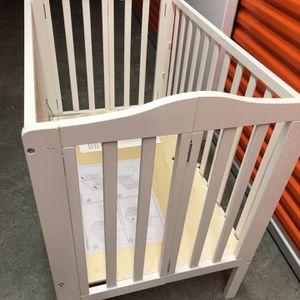 Delta Foldable Mini Crib for Sale in Seattle, WA