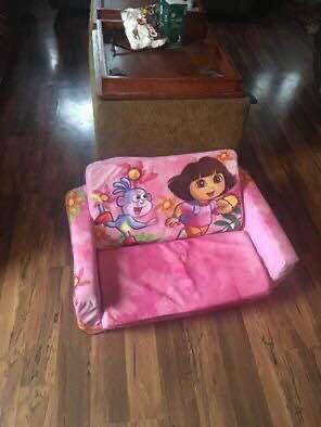 Nickelodeon Dora the explorer Children's 2 in 1 Flip Open Foam chair/Sofa Made of lightweight foam Opens to a foam bed for Sale in Everett, WA