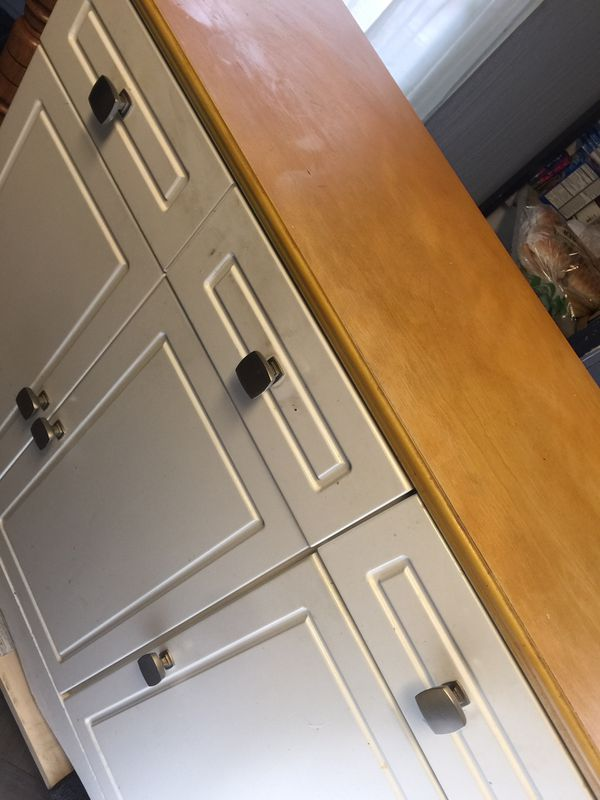 Kitchen island with stainless steel knobs
