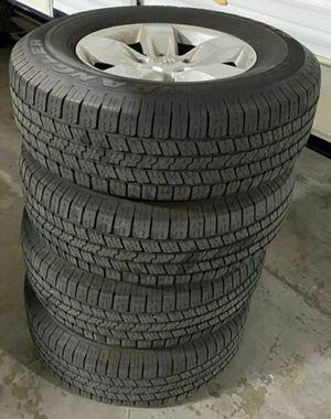 DODGE RAM 1500 RIMS AND TIRES 265/70/17 EXCELLENT CONDITION 90% THREAD ALL MATCHING GOODYEAR WRANGLER SRA TIRES for Sale in San Bernardino, CA